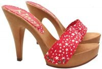 Red craft mules with white stars by Kiara Shoes